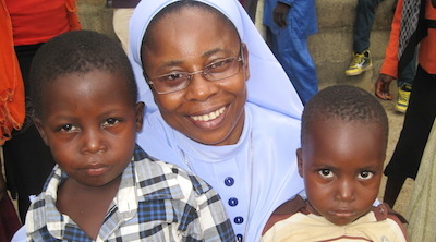 Sister Caroline with some children